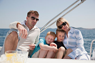 Family sitting together on yacht