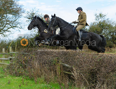 Jumping a fence near Mr Wilson's convert - The Cottesmore Hunt at Braunston, 12-11-13.
