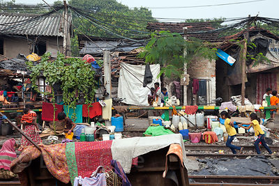 A slum area on the railway tracks near New Alipore Station, Kolkata, India. Many slum areas in Kolkata focus on an industry, ...