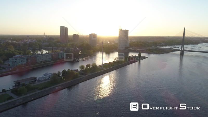 Aerial drone flyby shot of a large flag of Latvia during sunset in Riga, capital of Latvia.