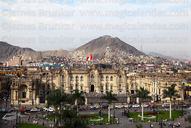 View of Plaza de Armas and government palace, Cerro San Cristobal in background, Lima, Peru