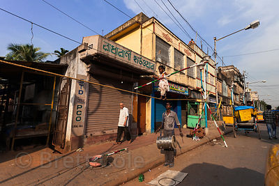 A man trains his five year old daughter to walk a tightrope in Taratala, Kolkata, India. She will perhaps work for tips in a ...