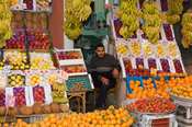 man selling fruit in the market, Streetscene, Alexandria, Egypt