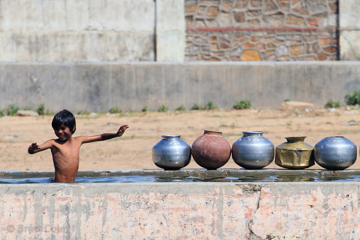 A boy swims in a trough, Pushkar, Rajasthan, India