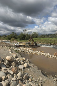 Heavy equipment excavating rocks from the Rio General in San Isidro, Costa Rica. They will be crushed and used for gravel.