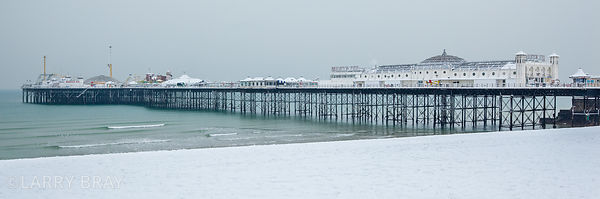 Brighton Pier and beach in snow in Brighton, East Sussex, UK