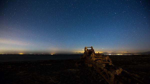 Wide Shot: Star Filled Sky Over A Dried Up Lake Bed