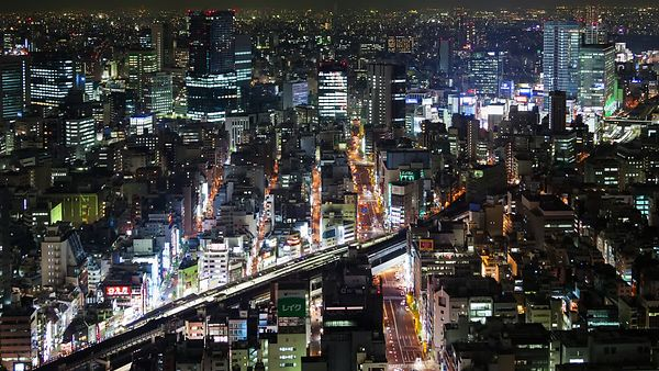 Bird's Eye: Boulevards & Trains Tracks of Light In The Darkness of Night Time Tokyo