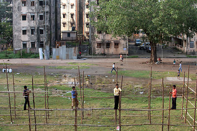 Workers frame an apartment building near Antop Hill in Mumbai, India.
