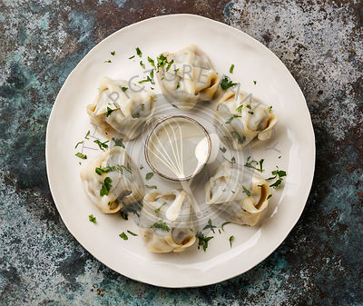 Traditional steamed dumplings Manti with Yogurt sauce