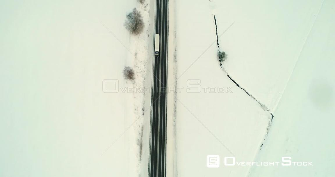 Truck on a Winter Road, Aerial, Tilt Up, Drone Shot, of a Lorry Driving in the Scandinavian Countryside, on a Icy Road, on a ...