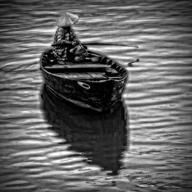 Man in Boat on River in Hoi An