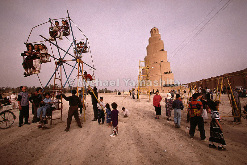 The Malwiya Minaret seems to have been inspired by Mesopotamian ziggurats like the Biblical Tower of Babel, where multiple languages were brought to the world's peoples after the Great Flood. It still stands guard over the remains of the Great Mosque of Samarra, and a children's playground, complete with hand-cranked Ferris wheel.