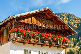 A traditional South Tyrol chalet house in the Dolomites.