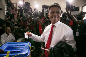 Malagasy Presidential Candidate Marc Ravalomanana casts his ballot paper for the 2nd round of the presidential election at a ...