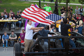 Parade floats pass by on Clinton St during the  University of Iowa homecoming Parade in Iowa City on Friday September 28, 201...