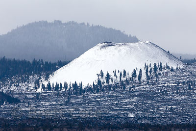 Snow-covered cinder cone butte in the Lava Beds National Monument, California