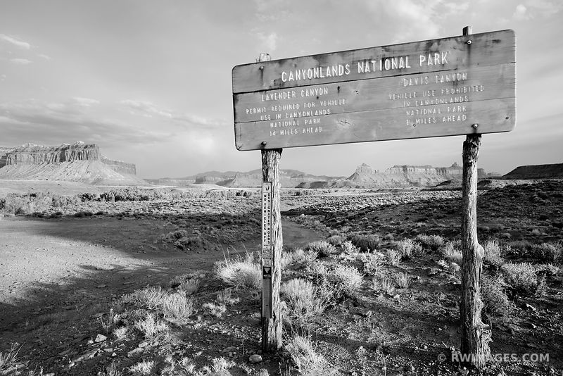 OLD CANYONLANDS NATIONAL PARK WOODEN SIGN THE NEEDLES DISTRICT CANYONLANDS NATIONAL PARK UTAH BLACK AND WHITE