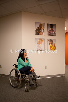 Woman in a wheelchair at an art gallery