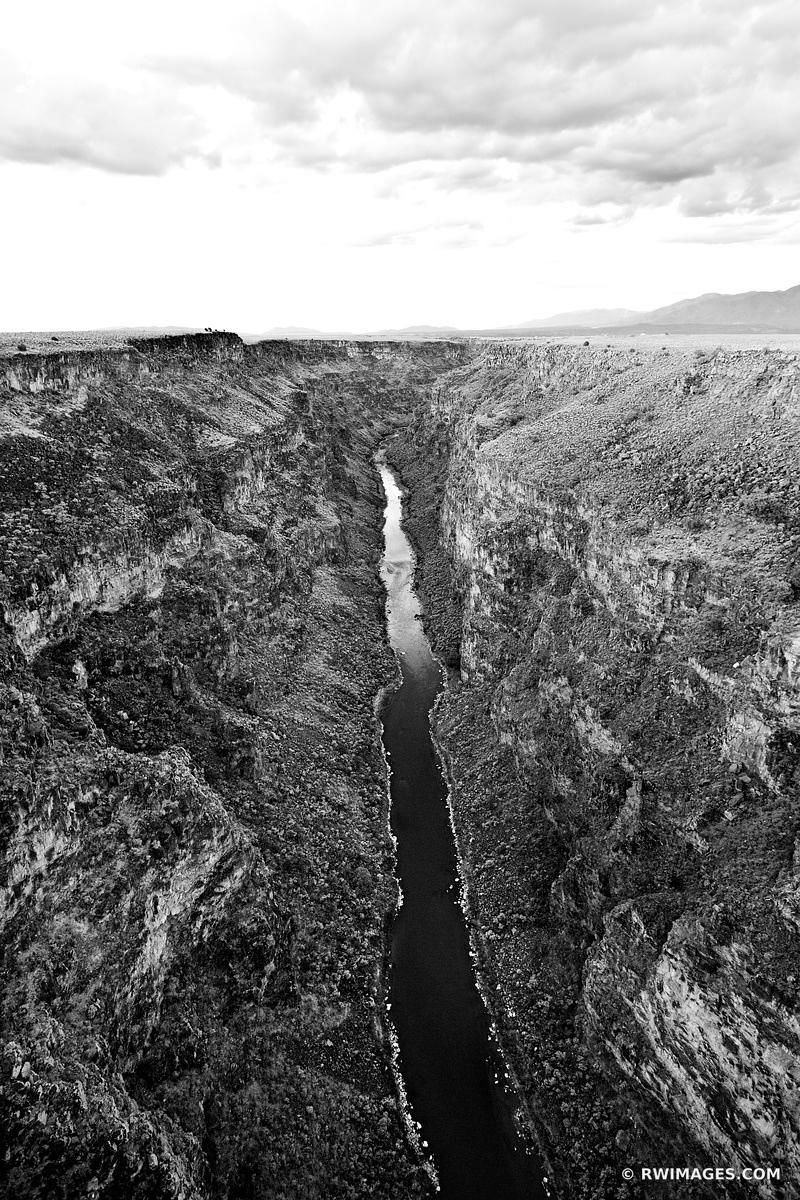RIO GRANDE GORGE NEAR TAOS NEW MEXICO BLACK AND WHITE VERTICAL