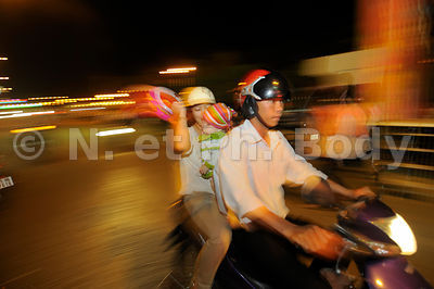 VIETNAM, CAN THO, FETE DU TET//Vietnam, Mekong delta, Can Tho, people on their bikes