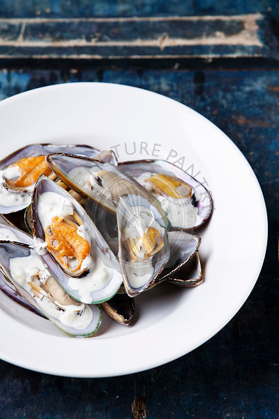 Prepared mussels on white plate