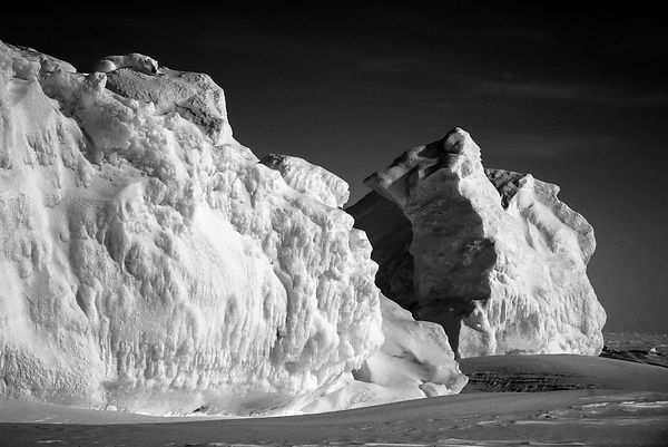 7021-Polar_bear_sleeping_on_top_of_the_iceberg_Baffin_Island_Canada_2016_Laurent_Baheux
