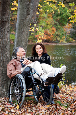 A man in a wheelchair in his garden in Fall