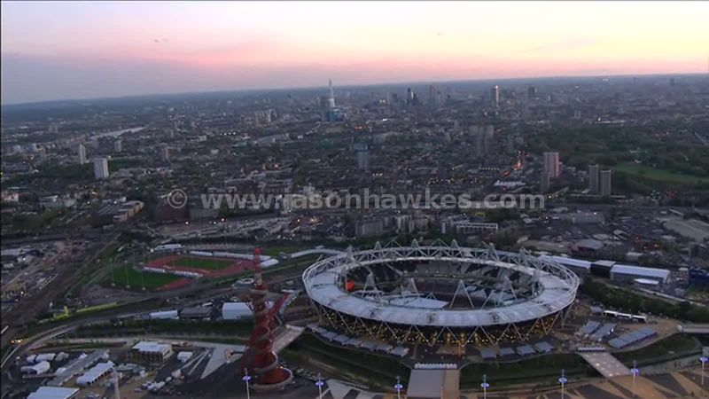 Aerial footage of the Olympic Park at dusk, Stratford, London, England, UK