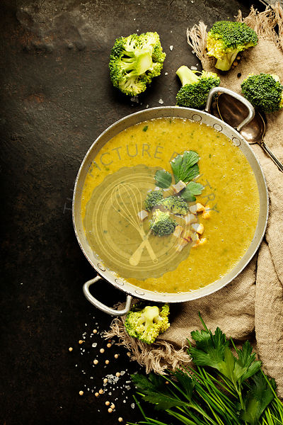 Homemade broccoli soup puree on a dark rustic background