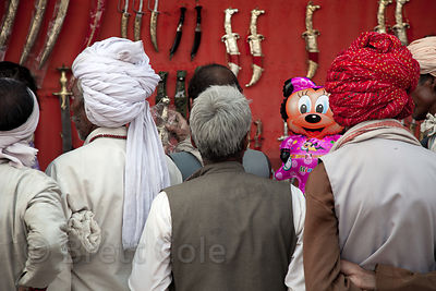 Disney balloon in a sword seller's stall, Pushkar, Rajasthan, India