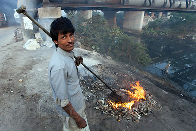 Scrap metal recycling being burned near Bantala, Kolkata, India.