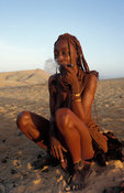 Himba woman smoking a traditional pipe, Kunene region, Kaokoland, Namibia