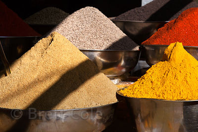 Brightly colored chili and turmeric powder for sale at a market in Udaipur, Rajasthan, India