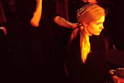 A model has her hair made up at London Fashion Week 2001