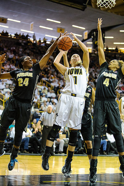 Iowa's Alexa Kastanek (1) splits the Purdue defenders Andreona Keys (24) and Torrie Thornton (4) during the second half of pl...