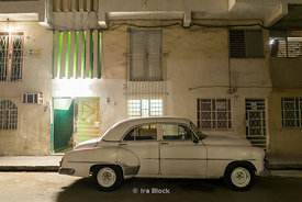 A car parked at night on a Havana street in Cuba,