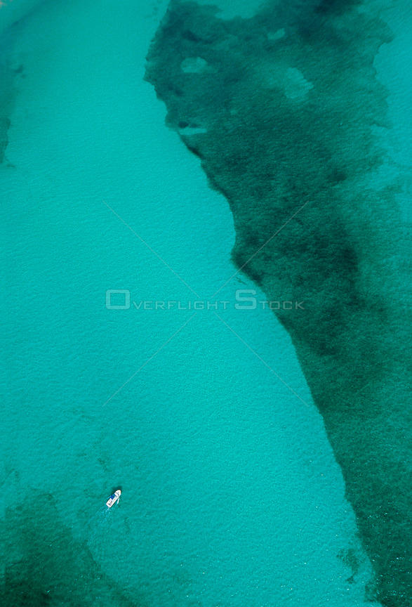 Aerial view of underwater sand formations and yacht, near Cancun, Caribbean Sea, Mexico, January
