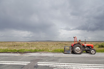 Man on a red tractor, Connemara, Ireland