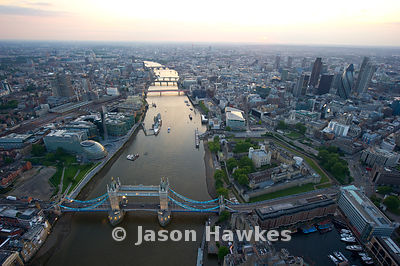 Aerial view over Tower Bridge, River Thames and City of London.