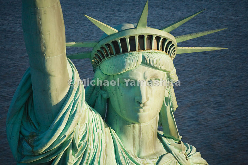 The Statue of Liberty's serene face has watched over the New York harbor since 1886.