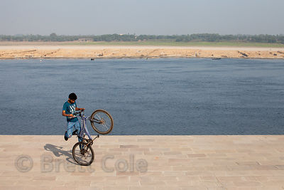 BMX riders perform tricks near Nagwa Ghat, Varanasi, India.