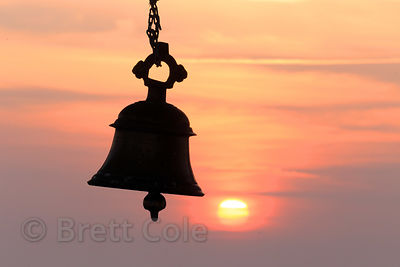 Bell at sunrise, Pachmantha Mataji mountaintop temple, near Majhewla village, Rajasthan, India
