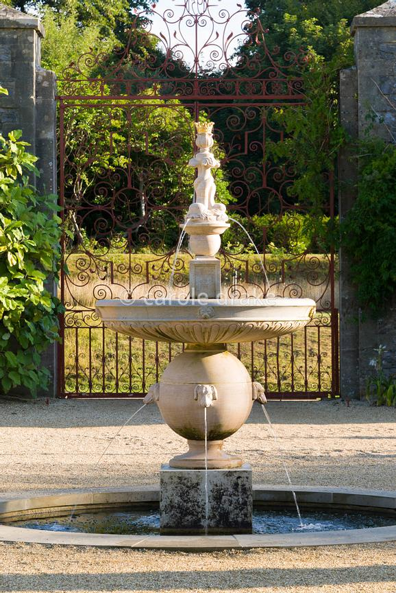 Upper terraces in the Collector Earl's Garden feature fountains with dogs' head spouts, designed by Julian and Isabel Bannerm...