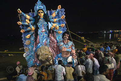 Durga Puja idols are immersed in the Hooghly River at night, Babughat, Kolkata, India