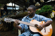 Mozambique, Maputo, Mercado Janeta. Guitar Player