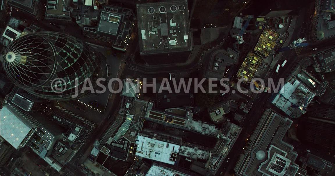 London Aerial Footage overhead of 30 St Mary's Axe towards 20 Fenchurch Street.
