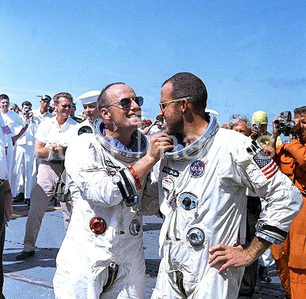(29 Aug. 1965) --- Astronaut Charles Conrad Jr. tweaks astronaut L. Gordon Cooper's eight-day growth of beard for the cameram...