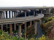 Funchal airport runway crosses a motorway and road intersection