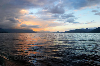 Steely blue and pink-orange hues on the fjords of the Pacific Ocean, Great Bear Rainforest, British Columbia